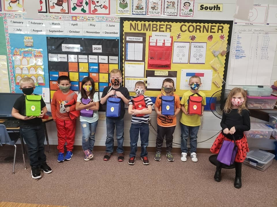 Saranac Elementary students posing with donated lunch boxes